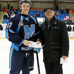 NEWMARKET, ON - Feb 9 : Ontario Junior Hockey League Game Action between the St. Michaels Buzzers and the Newmarket Hurricanes, Jake Evans #17 of the St.Michael's Buzzers Hockey Club receives player of the game honours.<br /> (Photo by Brian Watts / OJHL Images)