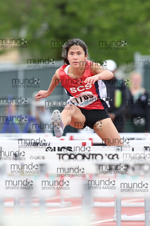 Alexandra Lee of St Clement's School - Toronto competes in the sprint hurdle heats at the 2013 OFSAA Track and Field Championship in Oshawa Ontario, Thursday,  June 6, 2013.<br /> Mundo Sport Images / Sean Burges