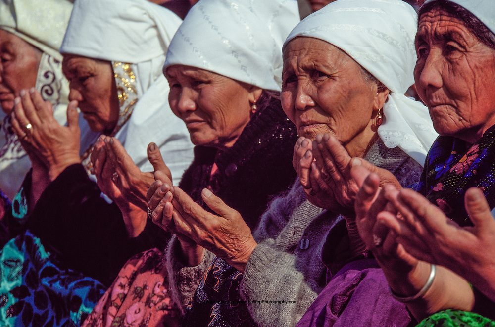 Muslim women pray at the Auezov jubilee celebrations at Borli-Aul in eastern Kazakhstan.