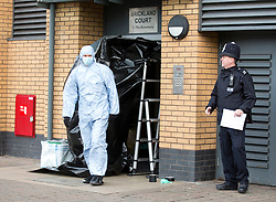 © Licensed to London News Pictures. 15/12/2014. Police officers and forensics investigate the murder of a man stabbed at his home in Brickland Court, The Broadway, in Edmonton, north London, UK. Photo credit : Isabel Infantes / LNP