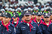 23 NOVEMBER 2012 - BANGKOK, THAILAND:  Thai riot police stand in formation in Bangkok Friday. Thai authorities have imposed the Internal Security Act (ISA), that enables police to call on the army if needed to keep order, and placed thousands of riot police in the streets around Government House in anticipation of a large anti-government protest Saturday. The group sponsoring the protest, Pitak Siam, said up to 500,000 people could turn out to protest against the government. They are protesting against corruption in the current government and the government's unwillingness to arrest or pursue fugitive former Prime Minister Thaksin Shinawatra, deposed in 2006 coup and later convicted on corruption charges. The current Thai Prime Minister is Yingluck Shinawatra, Thaksin's sister.      PHOTO BY JACK KURTZ