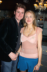 MR HARRY & LADY PORTIA BAKER at a party to celebrate the birthdays of Camilla Hacking, Micki Hacking and Colin Fitzgerald held at The Baglioni Hotel, 60 Hyde Park Gate, London SW7 on 22nd January 2005.<br />