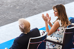 US President Donald Trump and his wife First Lady Melania Trump seen as they attend Bastille Day Military Parade, Place de la Concorde, in Paris on July 14, 2017. Photo by Ammar Abd Rabbo/ABACAPRESS.COM