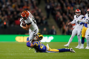 LA Rams Defensive back Taylor Rapp (24) tackles Cincinnati Bengals Tyler Eifert (85) during the International Series match between Los Angeles Rams and Cincinnati Bengals at Wembley Stadium, London, England on 27 October 2019.