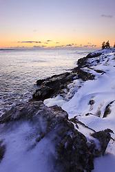 Dawn over the Atlantic Ocean in winter as seen from near Schooner Head on Maine's Acadia National Park.
