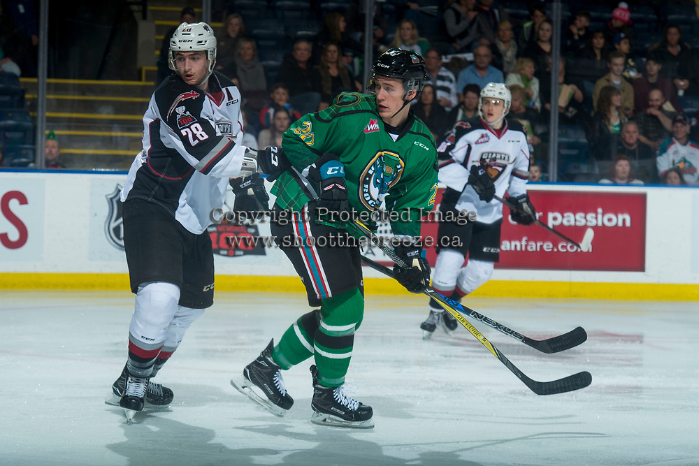 KELOWNA, CANADA - MARCH 18: Darian Skeoch #28 of the Vancouver Giants back checks Conner Bruggen-Cate #20 of the Kelowna Rockets during second period against the Vancouver Giants  on March 1, 2018 at Prospera Place in Kelowna, British Columbia, Canada.  (Photo by Marissa Baecker/Shoot the Breeze)  *** Local Caption ***