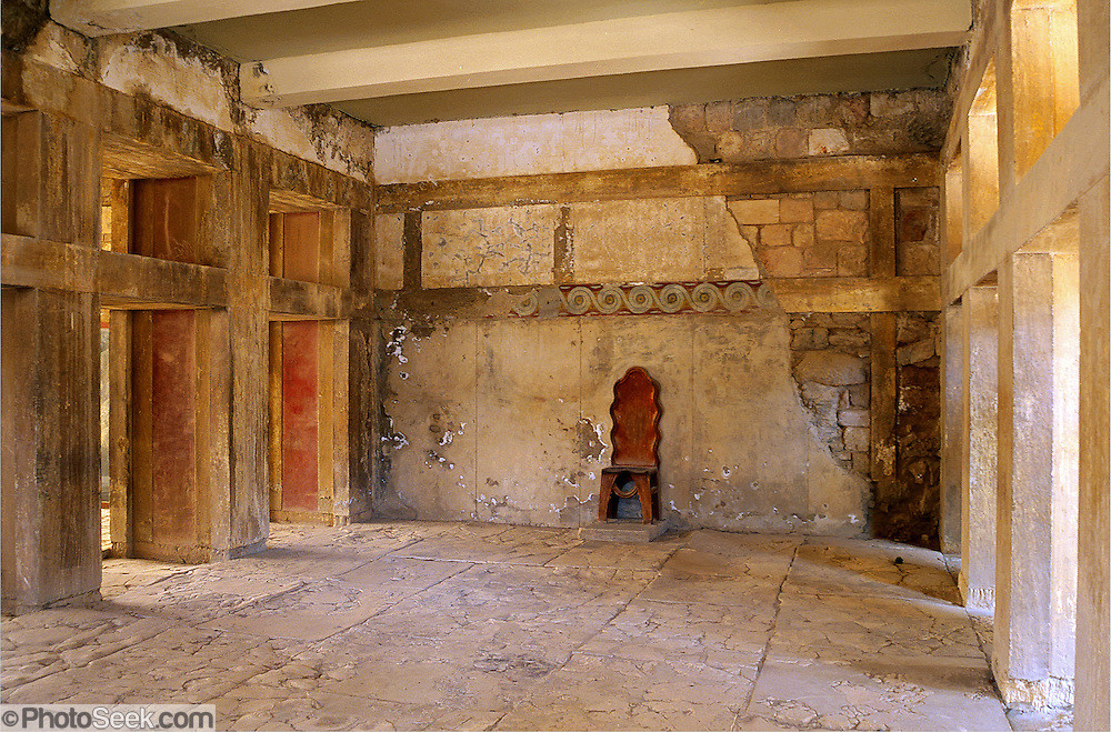 "A Minoan stone room with pier and door partitioning and chair are restored in the Knossos palace, at Heraklion (Iraklion), Crete, Greece, Europe. Knossos is a Minoan archeological site associated with the Labyrinth and Minotaur of Greek mythology. The Bronze Age palace of Knossos was first built around 1900 BC, destroyed by a large earthquake or foreign invaders in 1700 BC, rebuilt more grandly, then damaged several more times by earthquakes, by invasions, and in 1450 BC by the colossal volcanic eruption of Thera (modern Thira or Santorini). Invading Mycenaeans used Knossos as their capital as they ruled the island of Crete until 1375 BC. Archaeologist Arthur Evans excavated the Palace at Knossos from 1900-1905 and named the Minoan civilization of Crete after king Minos from Greek mythology. Homer's epic poems of the Iliad and Odyssey are the first Greek literature to mention Minos as a king of Knossos, Crete. Minos was son of Zeus and Europa. Every nine years Minos made King Aegeus pick seven men and seven women to go to the Labyrinth to be eaten by the Minotaur, a creature half man and half bull. After his death, legendary Minos became a judge of the dead in Hades. The vast building complex at Knossos is popularly thought to be the site of the Labyrinth, which Greek mythology says was designed by architect Daedalus with such complexity that no one could ever find its exit. Published by Thames & Hudson Ltd in the book ""Art and Archaeology of the Greek World"" by Richard Neer 2012."
