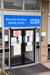 Coronavirus warning signs on Norwich Practices Health Centre entrance, Norwich UK March 2020