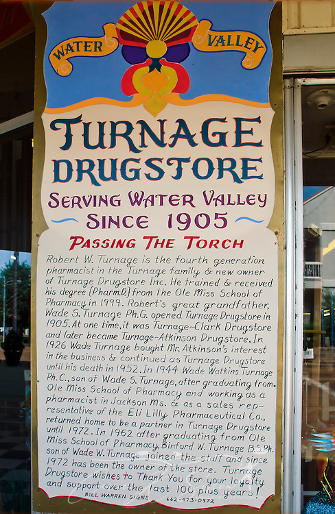 A sign outside Turnage Drug Store in Water Valley, Mississippi tells the store's history. The store has been open since 1905. (Photo by Carmen K. Sisson/Cloudybright)