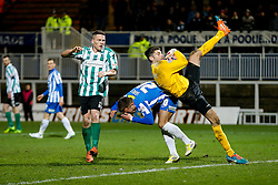 Dan Jones of Hartlepool United collides with his own keeper Scott Flinders  as Daniel Maguire of Blyth Spartans looks on - Photo mandatory by-line: Rogan Thomson/JMP - 07966 386802 - 05/12/2014 - SPORT - FOOTBALL - Hartlepool, England - Victoria Park - Hartlepool United v Blyth Spartans - FA Cup Second Round Proper.