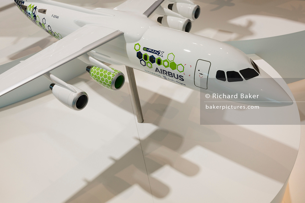 A scale model of the Airbus E-Fan X aircraft in the company's hospitality chalet at the Farnborough Airshow, on 18th July 2018, in Farnborough, England. The Airbus E-Fan is a prototype two-seater electric aircraft that was under development by Airbus.
