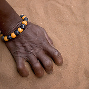 "Beads worn by members of a local shrine in Aflao, Volta Region, Eastern Ghana. Despite most Ghanaians being adamant followers of christianism or islam, many of them still maintain traditional beliefs. When facing a problem of any nature, some people will visit a local fetish shrine, looking for help. The main priest will consult the oracles and tell the person in need what has to be done for the problem to go away. People will typically be asked to ""serve"" the shrine for weeks, sometimes months, as their families pay the priest for their upkeep."