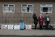 Three anti-abortion campaigners stand vigil opposite Marie Stopes International in Whitfield Street, W1, on 16th January 2019, in London, England.