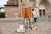 artist painting a city scene