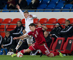 16.11.2013, Cardiff City Stadium, Cardiff, WAL, Fussball Testspiel, Wales vs Finnland, im Bild Wales' Sam Vokes, action against Alexander Ring of Finland // during the international friendly match between Wales and Finland at the Cardiff City Stadium in Cardiff, Great Britain on 2013/11/17. EXPA Pictures © 2013, PhotoCredit: EXPA/ Propagandaphoto/ Kieran McManus<br /> <br /> *****ATTENTION - OUT of ENG, GBR*****