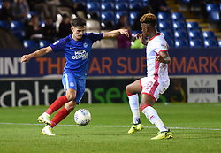Liam Shephard of Peterborough United in action with Aaron Tshibola of Milton Keynes Dons - Mandatory by-line: Chantelle McDonald/JMP - 12/09/2017 - FOOTBALL - ABAX Stadium - Peterborough, England - Peterborough United v Milton Keynes Dons - Sky Bet League One