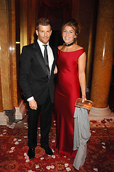TOM AIKENS and his wife AMBER at a party to celebrate the launch of the 'Inde Mysterieuse' jewellery collection held at Lancaster House, London SW1 on 19th September 2007.<br />