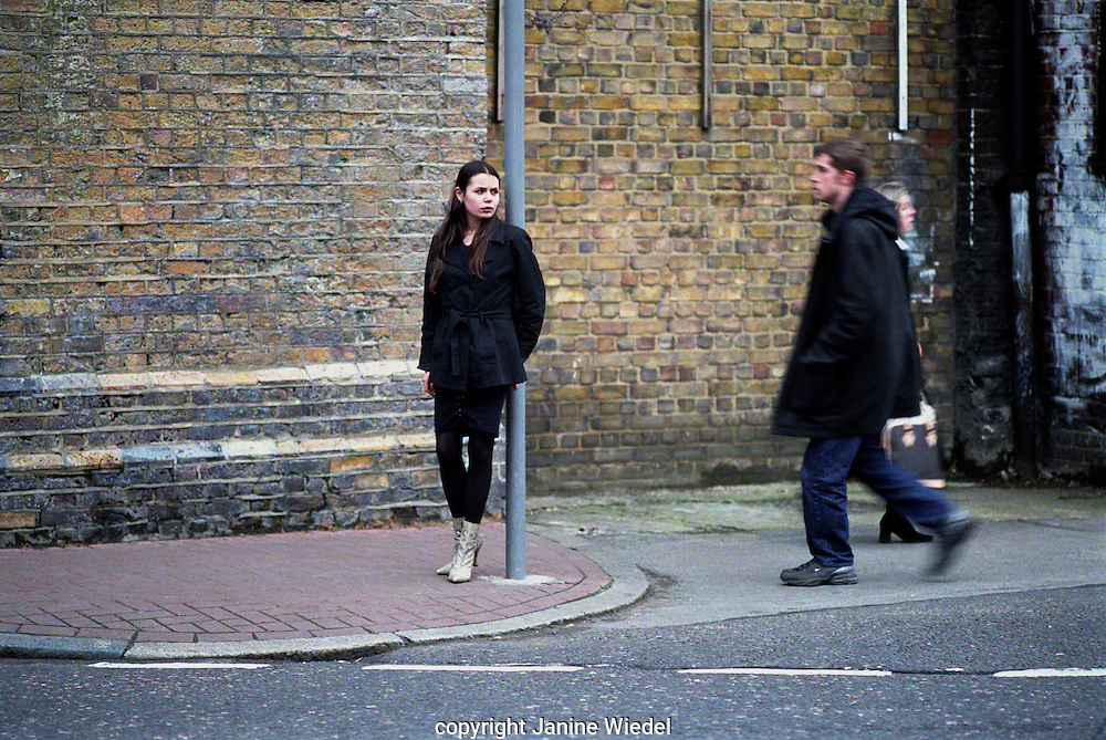 Young female prostutute soliciting in the backstreets of London.