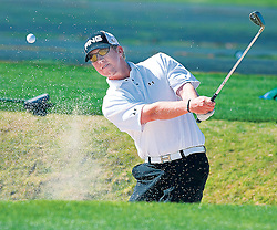 Hunter Mahan blasts out of sandtrap
