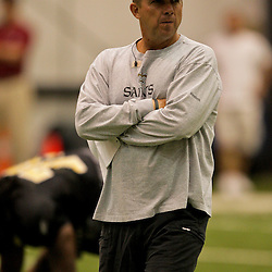 12 August 2009: Saints head coach Sean Payton walks among players as they stretch during New Orleans Saints training camp at the team's indoor practice facility in Metairie, Louisiana.