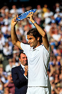 LONDON, ENGLAND - JULY 06: Roger Federer of Switzerland poses with the Gentlemen's Singles Trophy following his defeat in the Gentlemen's Singles Final match against Novak Djokovic of Serbia on day thirteen of the Wimbledon Lawn Tennis Championships at the All England Lawn Tennis and Croquet Club on July 6, 2014 in London, England.
