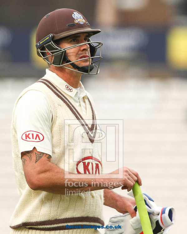 Kevin Pietersen of Surrey County Cricket Club is taken LBW by Jesse Ryder of Essex County Cricket Club during the LV County Championship Div Two match at the Kia Oval, London<br /> Picture by Mark Chappell/Focus Images Ltd +44 77927 63340<br /> 26/04/2015