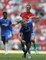 Photo: Rich Eaton.<br /> <br /> Manchester United v Chelsea. FA Community Shield. 05/08/2007. Chelsea's Joe Cole gets to the ball ahead of United's John O'Shea.