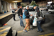 November 8, 2016 - Ventimiglia, Italy: Jean-Pierre, 70, hands out food rations to migrants in Ventimiglia, he  is a retired policeman, member of a network that helps migrants from Ventimiglia, Italy, with shelter, food and transportation.<br />  <br /> 8 novembre 2016 - Vintimille, Italie: Jean-Pierre, 70 ans, distribue des rations alimentaires aux migrants, il est un policier retraité, membre d'un réseau qui aide des migrants à Vintimille, en Italie, à abriter, nourrir et transporter.