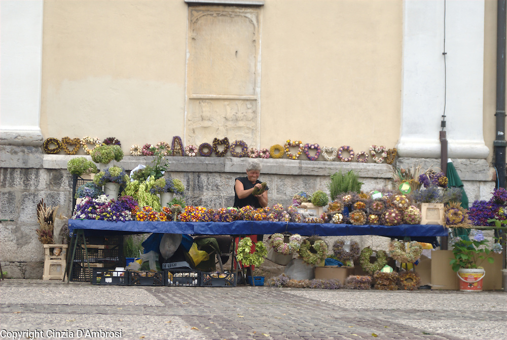 A flower seller outside Ljubljana Cathedral, Ljubljana, Slovenia