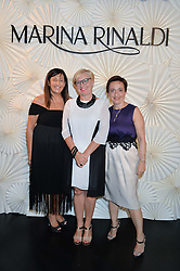 Left to right, FRANCESCA FERRETTI, LYNN WEBBER and ROSELLA COLOMBO at the launch of the new Marina Rinaldi flagship store at 5 Albemarle Street, London on 3rd July 2014.