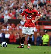 Wayne Rooney of Manchester United stands with his hands on his hips during the Barclays Premier League match between Manchester United and Birmingham City at Old Trafford on August 16, 2009 in Manchester, England.