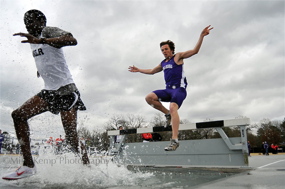 A UCA harrier prepares to hit the water while competing in the steeplechase.