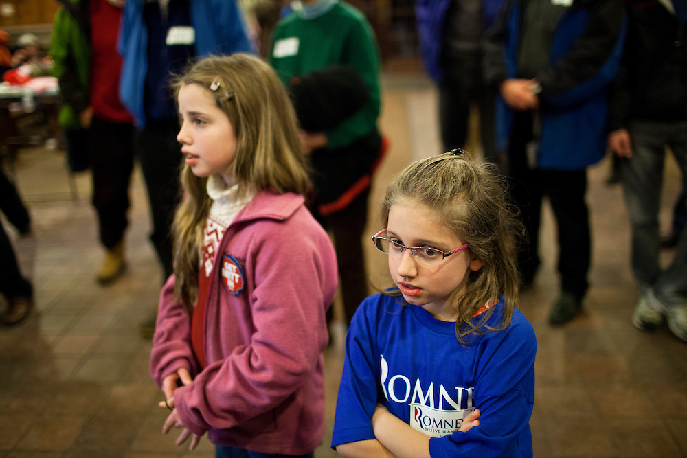 Children listen as Republican presidential candidate Mitt Romney hosts a spaghetti dinner on Friday, January 6, 2012 in Tilton, NH.