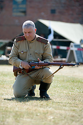 "Re-enactors portray Soviet soldiers from the Russian 13th Guards Rifle Division ""Poltavaskaya""<br />