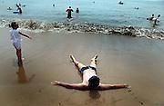 Chinese enjoying a hot summer day at the popular city of Qingdao.