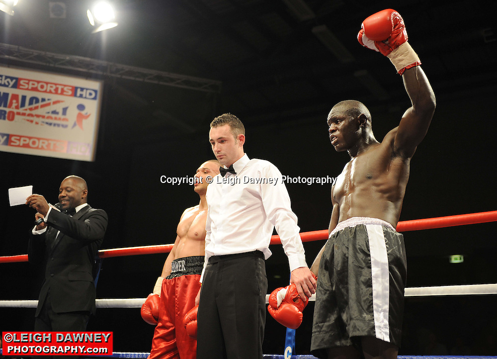 Erick Ochieng (black shorts) defeats Curtis Valentine at Gorsebrook Leisure Centre Dagenham on 14th May 2010. Frank Maloney Promotions. Photo credit: © Leigh Dawney