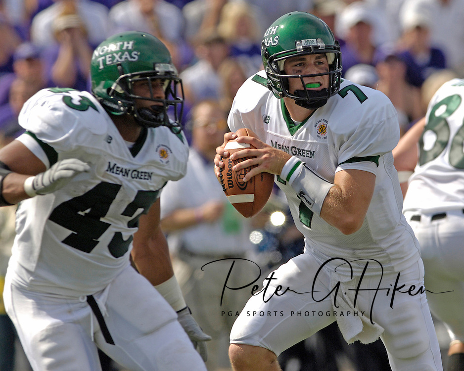 North Texas quarterback Daniel Meager (7) rolls back to pass, with protection from running back Patrick Cobbs (43), during the first half against K-State.  Kansas State defeated the Mean Green of North Texas 54-7 at KSU Stadium in Manhattan, Kansas on September 24, 2005.
