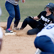 Post University infielder Lianna May (11) slides into second base in the fifth inning of game #1 of NCAA Central Atlantic Collegiate Conference (doubleheader) against Goldey-Beacom Saturday, March 30, 2013, at Nancy Churchmann Sawin Athletic Field in Wilmington Delaware.