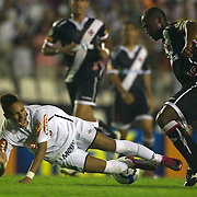Young Brazilian footballer and rising star Neymar in action for Santos as Vasco defender Jumar was sent off for this challenge on the youngster during the Vasco V Santos, Futebol Brasileirao League match at the Sao Januario Stadium, Rio de Janeiro,  Brazil. 28th September 2010. Photo Tim Clayton.