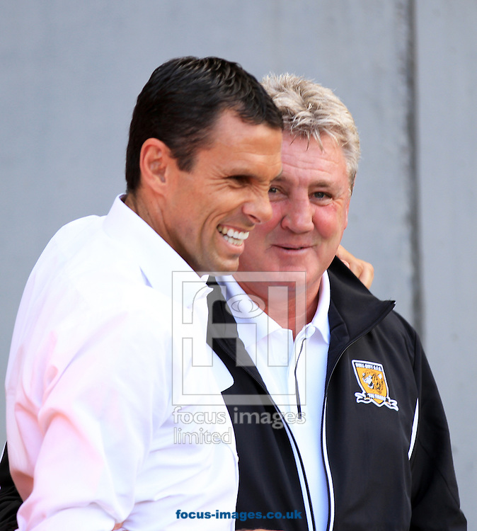 Picture by Richard Gould/Focus Images Ltd +44 7855 403186.18/08/2012.Steve Bruce manager (R) of Hull City and Gus Poyet manager (L) of Brighton and Hove Albion during the Barclays Premier League match at the KC Stadium, Kingston upon Hull.