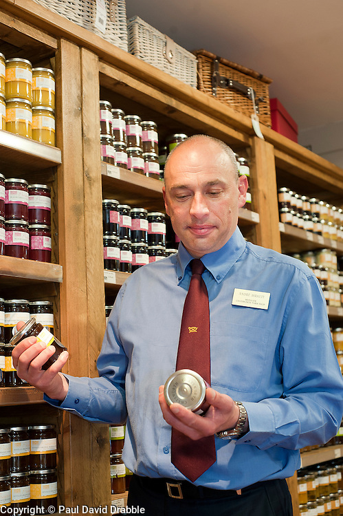 Andre Birckett Manager of Chatsworth Farm Shop checks the Preserves Display..10  May 2012.Image © Paul David Drabble