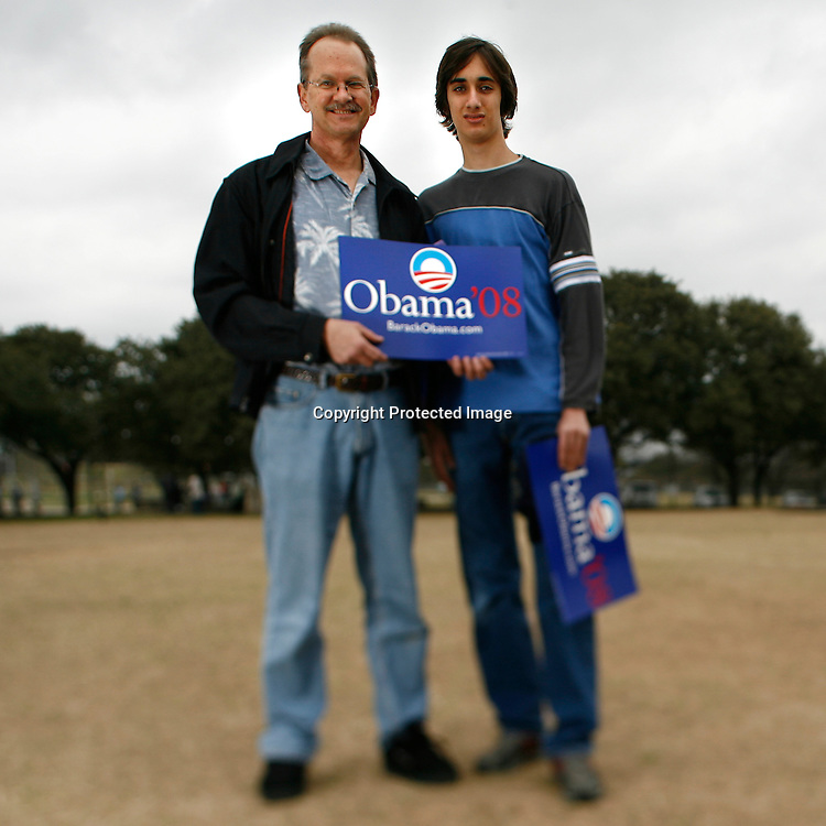 Randy Wohlert attends a rally held for U.S. Senator Barack Obama with his son Luke Wohlert in Austin, Texas, February 23, 2007.