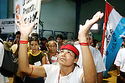 "09 SEPTEMBER 2003 - CANCUN, QUINTANA ROO, MEXICO: An indigenous Mexican woman participates in a blessing ceremony during the opening of the Forum for Indigenous People at the Casa de la Cultura in Cancun during the World Trade Organization Ministerial meetings. The indigenous forum was held as a ""trade fair"" counterpoint to the fair trade talks going on in the Mexican resort city.   PHOTO BY JACK KURTZ"