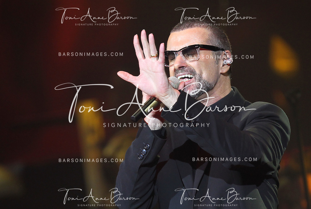 """NICE, FRANCE - SEPTEMBER 22:  George Michael Performs during the """"Symphonica Tour"""" at Palais Nikaia on September 22, 2011 in Nice, France.  (Photo by Tony Barson/WireImage)"""