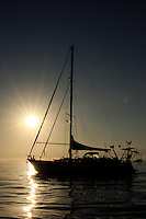 A silhouette of a sail boat anchored in the Bay of Banderas of the coast of La Cruz de Huana Caxtle.