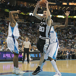 29 March 2009: San Antonio Spurs guard Manu Ginobili (20) drives between New Orleans Hornets defenders Hilton Armstrong (12) and Julian Wright (32) during a 90-86 victory by the New Orleans Hornets over Southwestern Division rivals the San Antonio Spurs at the New Orleans Arena in New Orleans, Louisiana.