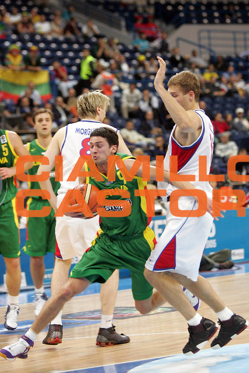 DESCRIZIONE : Belgrado Belgrade Eurobasket Men 2005 Lituania-Russia<br /> GIOCATORE : Gustas<br /> SQUADRA : Lituania Lithuania<br /> EVENTO : Eurobasket Men 2005 Campionati Europei Uomini 2005<br /> GARA : Lituania Russia Lithuania Russia<br /> DATA : 23/09/2005<br /> CATEGORIA :<br /> SPORT : Pallacanestro<br /> AUTORE : Ciamillo&amp;Castoria/Fiba Europe Pool