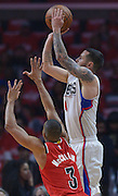 Los Angeles Clippers guard J.J. Redick #4 shoots over Portland Trail Blazers guard C.J. McCollum #3 in the first half. The Los Angeles Clippers played the Portland Trail Blazers in game 5 of the NBA Western Conference Playoffs first round. Los Angeles, CA.  April 27, 2016. (Photo by John McCoy/Southern California News Group)