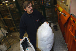 Man with a mild learning disability working as a factory operative, shown here operating machine to recycle plastic, helped into employment by the Ready 4 Work team, Nottinghamshire County Council