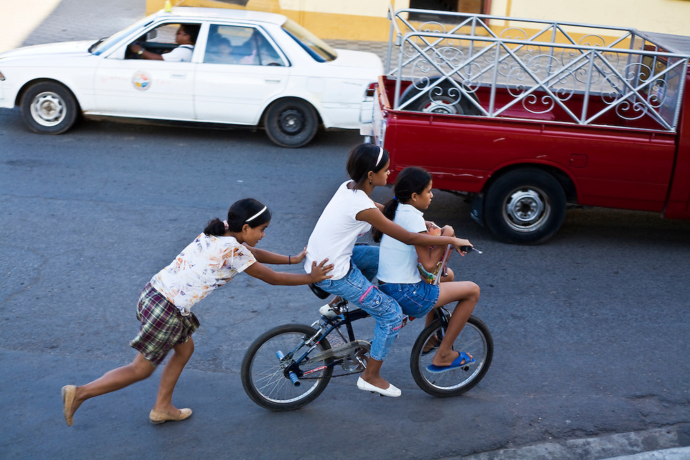 Pushing friends through the traffic. Granada is Nicaragua's most famous city. founded in 1524 it is one of best examples of Spanish colonial architecture in the Americas. .it has a varied history including its almost total destruction by filibuster William Walker in a childlike tantrum. Today it is a popular tourist town though retains a strong sense of its own identity.